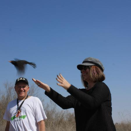 Ozlem releases a ringed blackbird